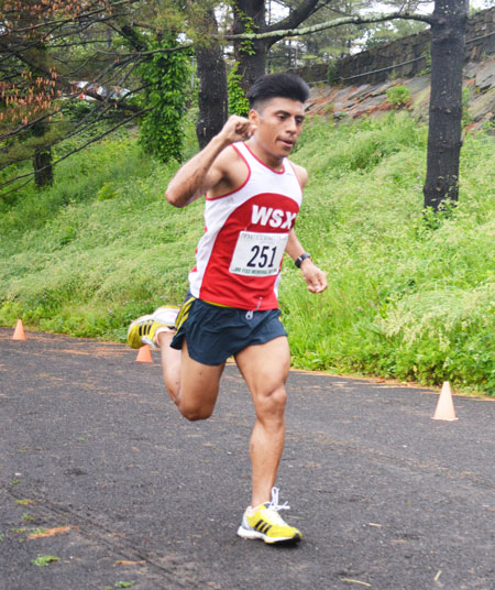 Brooklyn resident Alejandro Ariza, 26, was the overall champion during the annual Jim Fixx Memorial Day Road Race, posting a top time of 28:06. (photo courtesy of Michael Yardis / Threads and Treads)