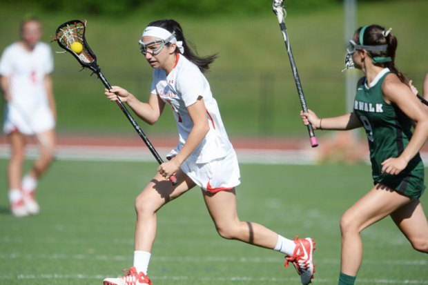 Greenwich High's Paige Mautner runs past a Norwalk defender in Tuesday's Class L first round game. (John Ferris Robben)
