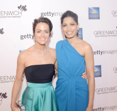 Wendy Reyes, who is on the board of directors for the Greenwich International Film Festival, poses for a photo with acrtress Freida Pinto, right, during the Changemaker Honoree Gala (John Ferris Robben photo)