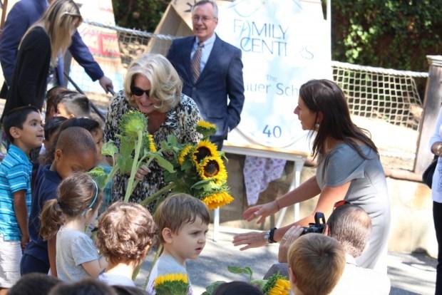 Laurie Grauer greets a preschool classroom during the renaming ceremony (Evan Triantafilidis Photo)