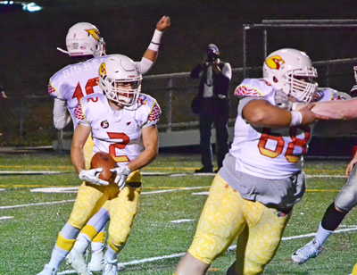 Greenwich High School's Kevin Iobbi looks to pick up some key yards on the ground during Big Red's game against New Canaan. (Paul Silverfarb photo)