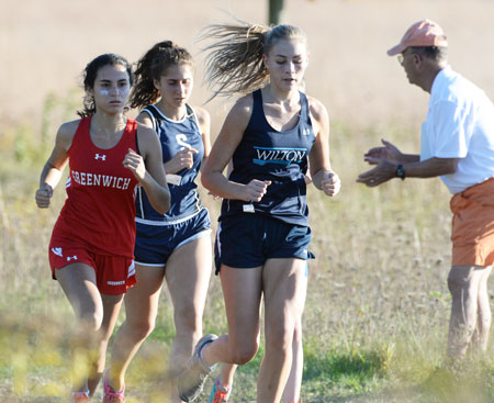 Greenwich High School's Beatriz Klein takes to the FCIAC championship course at New Canaan's Waveny Park. The GHS girls' team placed second overall in the championships. The boys' squad took home eighth on the day. (John Ferris Robben photo)