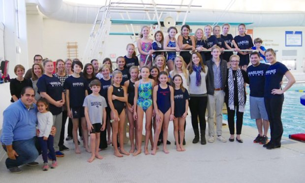 Powers family, YMCA Marlins Divers and coaches pose with the new 1-meter diving board