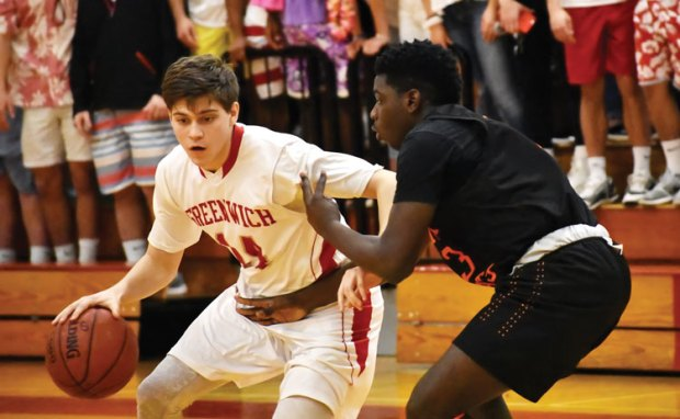 Greenwich High School senior captain Robert Clark looks to get past his Stamford defender during Tuesday night's victory. (Paul Silverfarb photo)