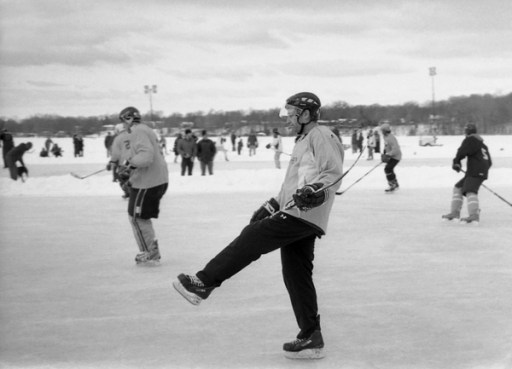 Hockey player on froze lake, Grand Rapids, Michigan