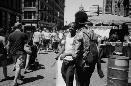 Friends bump into each other at the Festival of Arts 2011, Grand Rapids, Michigan