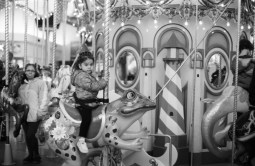Girl on Carousel, she doesn't look too thrilled.