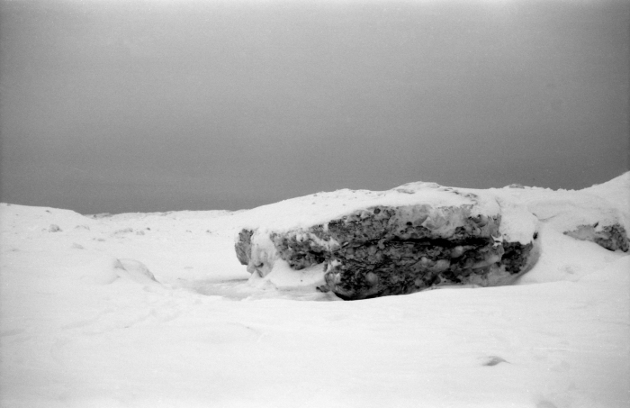 AGFA SUPER SILLETTE ACROS - Let me explain this. First off, we are on the frozen lake Michigan by the shore. Snow covered on top of the frozen lake. And this is not a rock, it's frozen lake water, beach sand and other sediments found in water, formed by wave.