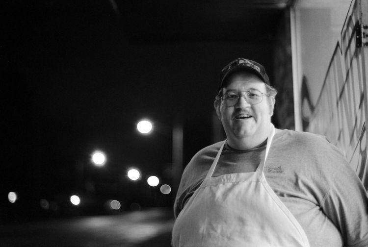 Proud owner of the pizza shop. Talking outside on a smoke break, well my smoke break it is.