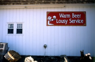 Warm Beer Lousy Services, Another funny sign behind another bar.