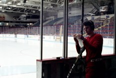 Dubuque Fighting Saints player taping up his stick before the game.
