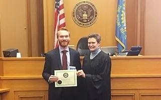 Davenport Evans lawyer Michael L. Snyder sworn in by The Honorable Karen E. Schreier