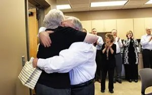 Colleen Emmons and Rick Orr Hug at their retirement party from Davenport Evans