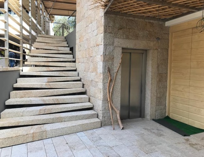 Solid Staircase Suspended In Yellow San Giacomo Granite