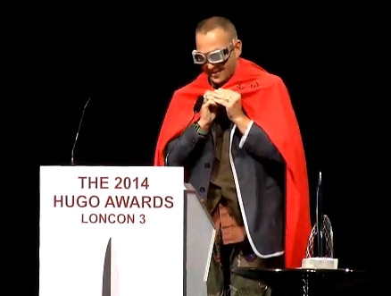 """Cory Doctorow accepting the Best Graphic Story Hugo Award for Randall Munroe's """"Time."""". Photo by Jim C. Hines"""