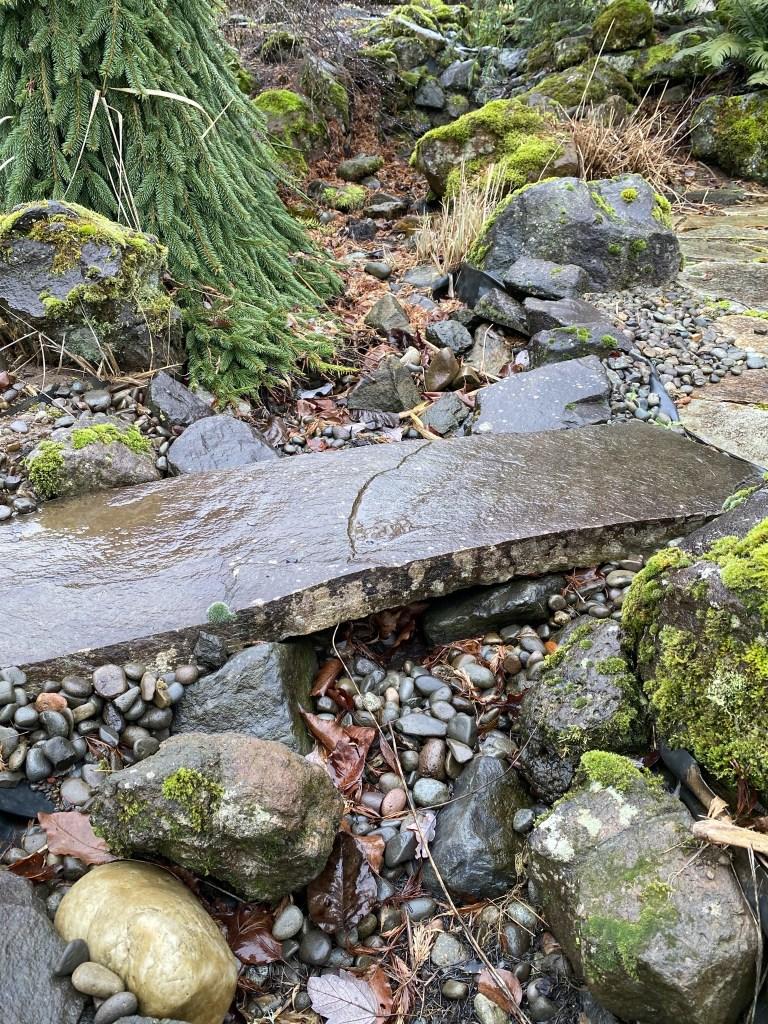 Stone bridge over stream bed