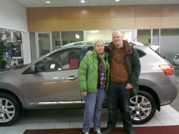 Jenn and David in front of new car