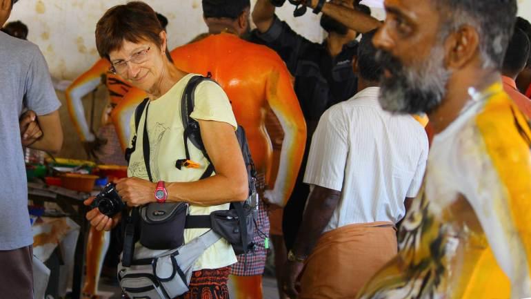 Puli-Kali-Pulikkali - A tourist, curiously watching the body painting