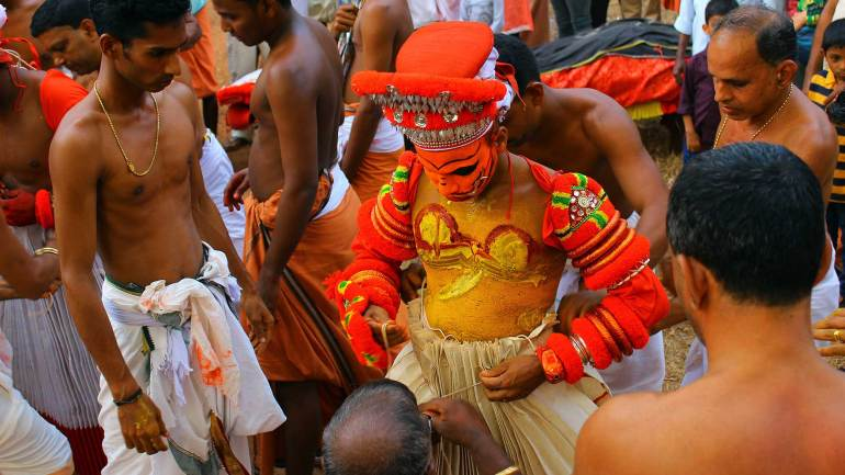 Wearing-the-costumes-(Theyyam-kettal)