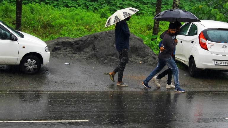 Kerala-Heavy-Rain-Kerala-Monsoon-students-walk-with-umbrella
