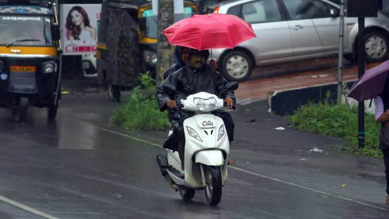 Kerala-Heavy-Rain-Kerala-Monsoon-two-wheeler-Passengers-with-umbrella
