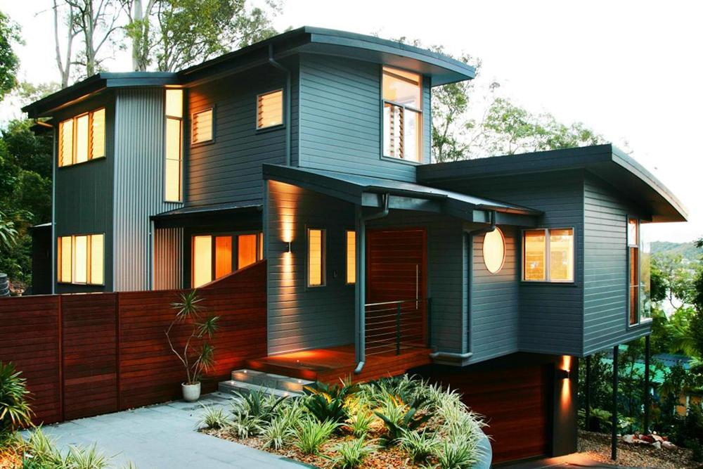 Warna Cat Dinding Luar Rumah yang Cerah Sentuhan Orange