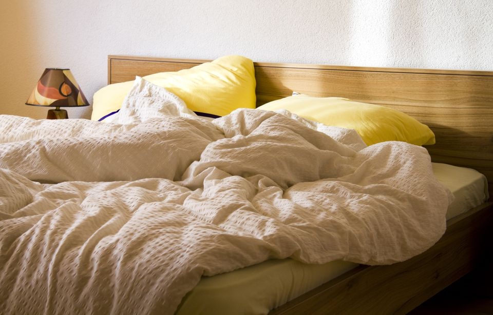 an-unmade-bed-with-yellow-pillows-in-the-morning-97921412-5aa1fe171d6404003778b8dd (1)
