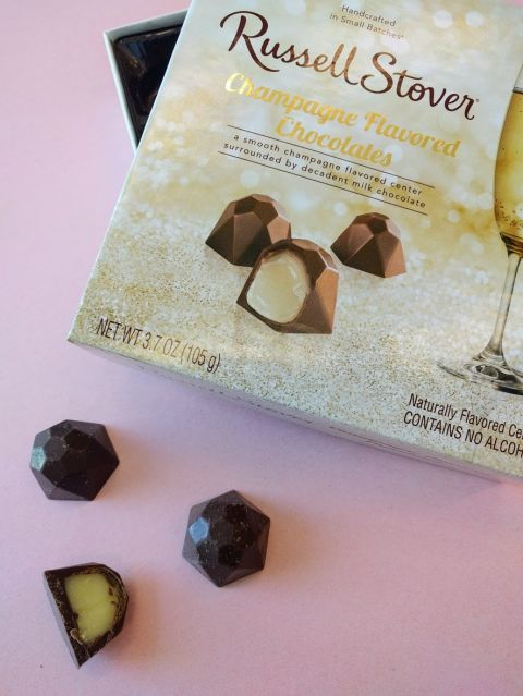 "After the Champagne and rosé gummy trend, it makes sense we'd see even more bubbly-inspired sweets. Russell Stover just launched a 9-piece box of truffles, which have a gooey, champers-flavored center, though they're totally alcohol-free (so no worries if your 6-year-old gets into 'em and declares himself ""chocolate wasted""). Target, $5"
