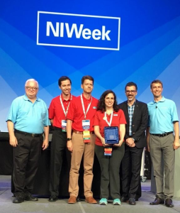 The Delacor leadership team receives the LabVIEW Tools Network Product of the Year award.