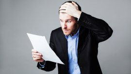 terrified businessman reading document