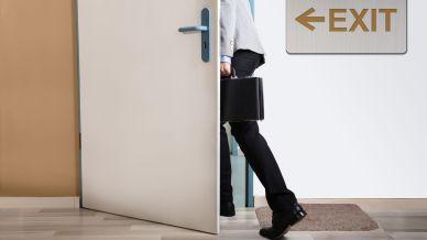 businessperson-walking-out-928080898-4098f0b8624741869bae2f6c093aea0a