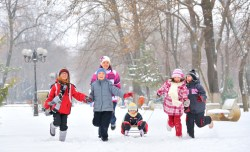 children bundled up running in snow