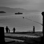 Fisherman looking across to Miyajima Island - Nikon D7000 Nikkor AF-S 35mm | Del Cook Photography