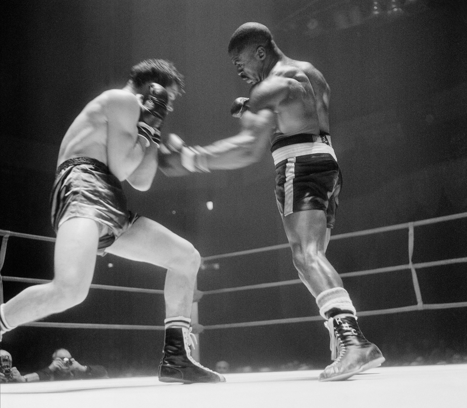 Rubin 'Hurricane' Carter (right) lands a punch on Fabio Bettini of Italy during their international middleweight match in Paris on Feb. 22, 1965. Carter beat Bettini by knockout in the 10th round