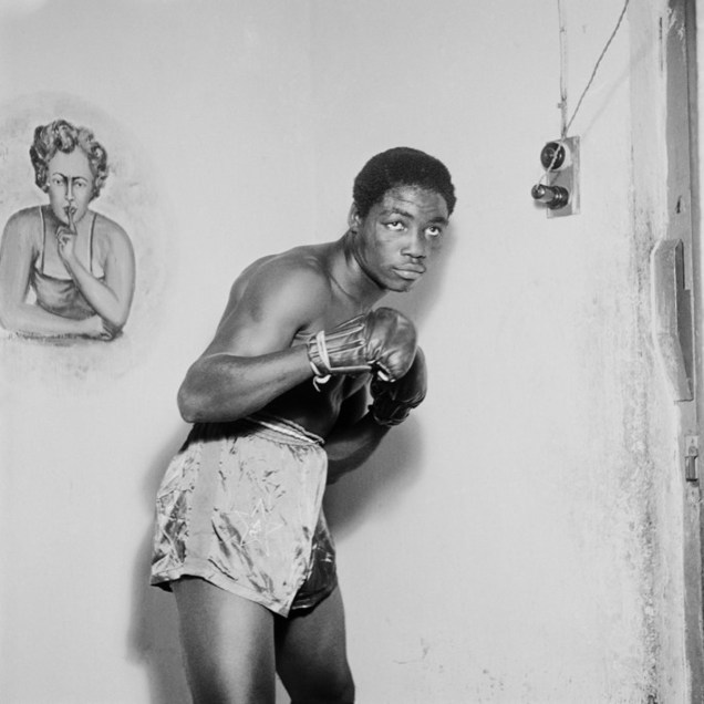 Ginger Nyarku Featherweight boxer with Coronation Belt, Accra (1953), Gelatin silver print 30x30, James Barnor, Courtesy of, Autograph ABP
