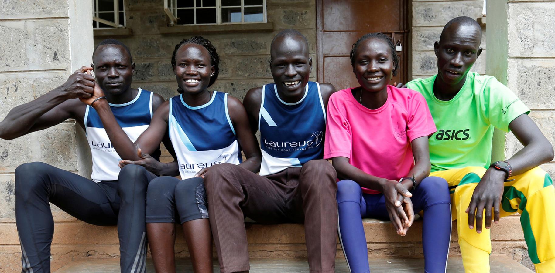 Athletes from South Sudan, (L-R) Paulo Amotun Lokoro of 1500m, Rose Nathike Lokonyen of 800m, Yiech Pur Biel of 800m, Anjelina Nada Lohalith of 1500m and James Nyang Chiengjiek of 400m | Source: Thomas Mukoya/REUTERS