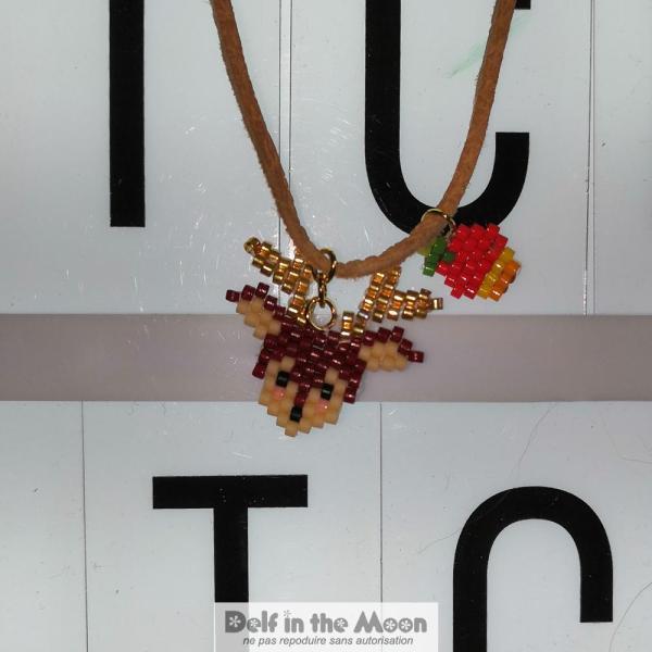 et un collier pour Alison (avec la pomme de Papa et le cerf de Maman)