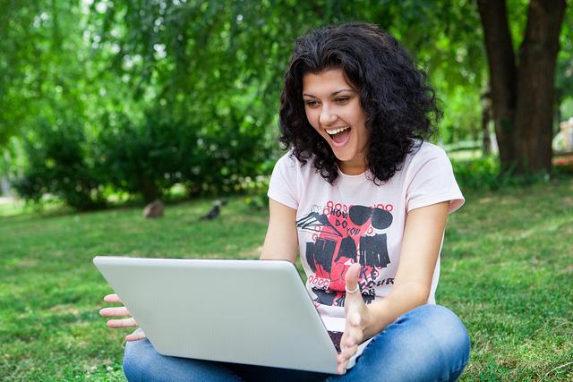 girl-using-laptop-in-park