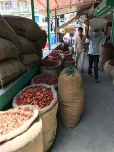 Visiting the red chilis section of spice market