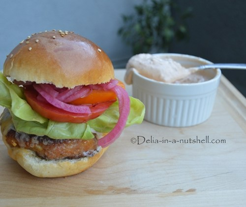 Juicy chicken burger with homemade soft buns, chipotle aioli and pickled onions