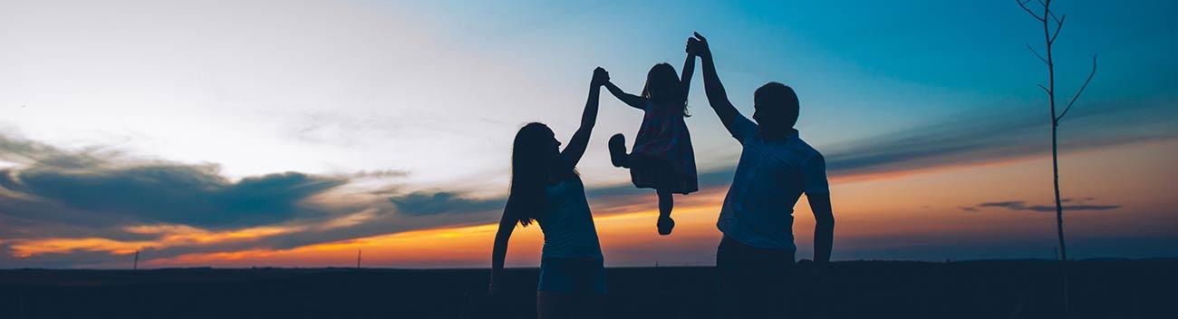 parents-lifting-child