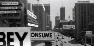 Kapitalistická společnost - saturovaná obrazovými výjevy, nesčetnými rozptýleními a nekonečnou komodifikací existence.
