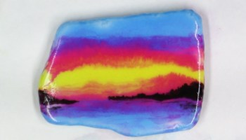 sunset colors painting on a white rock