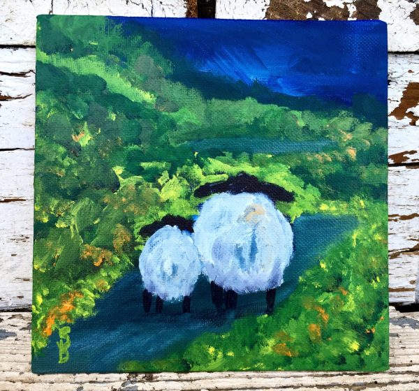 2 sheep in a green landscape