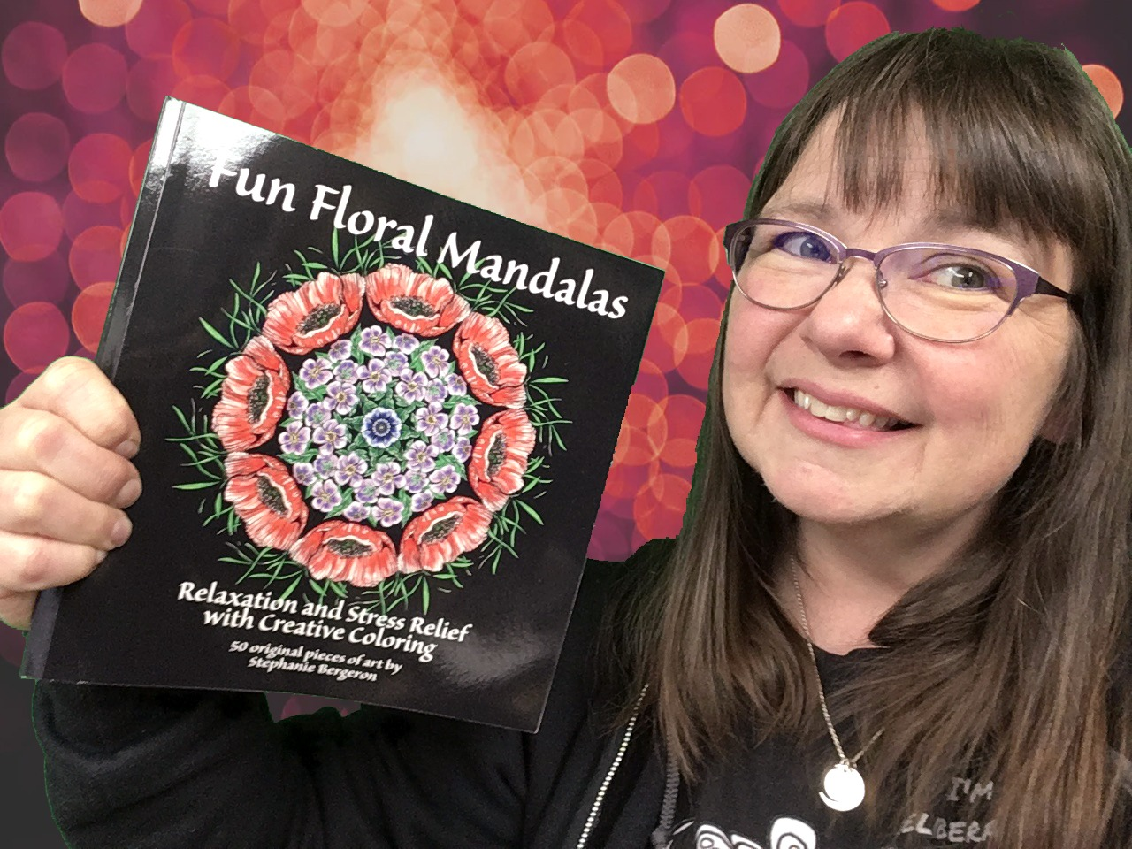 Woman holding up a coloring book