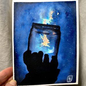 Night Sky -Hand holding up a jar