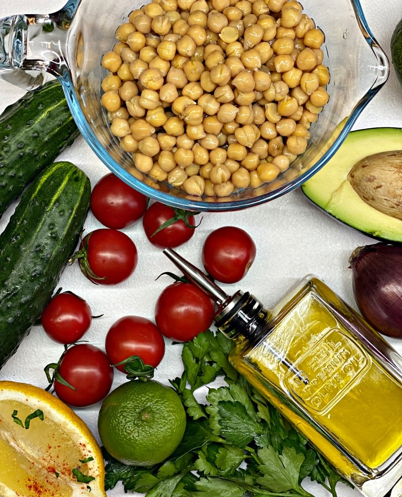 Chickpeas and avocado salad with olive oil dressing and the ingredients