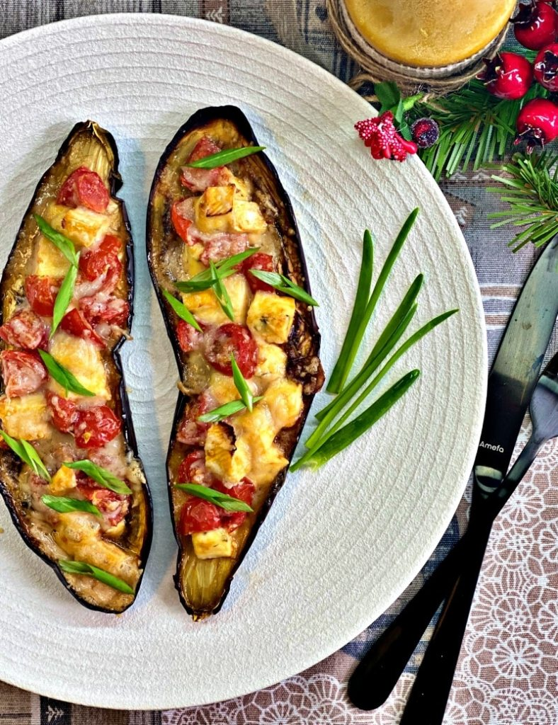 Baked eggplant with brie cheese and parmesan and tomatoes
