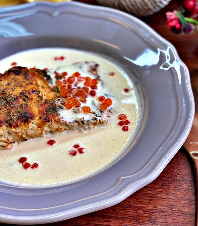 White fish and creamy sauce and red caviar