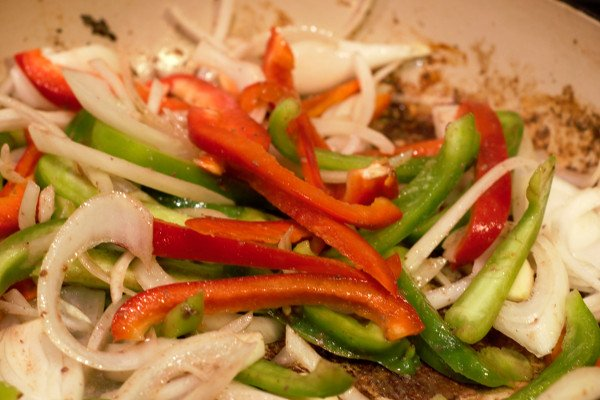 After browning the steak, lightly saute the vegetables. Then add wine to deglaze the pan, and begin the sauce.
